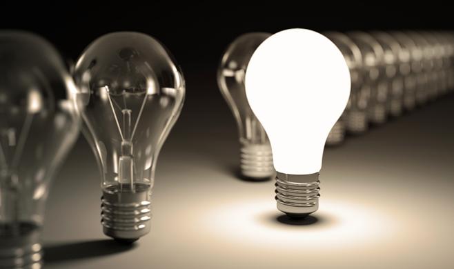 Long row of lightbulbs with 1 lit